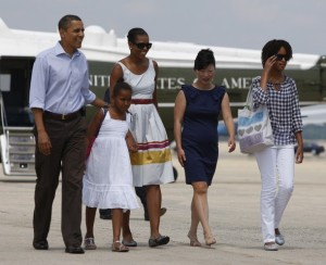 U.S. President Obama and the first family walk to Air Force One near Washington